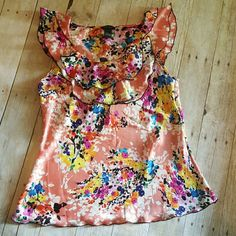 Flirty floral Colorful and flowy shirt! Multi colored, goes great with many colors! Girly ruffles in the from and on the sleeves. Only worn a few times,  in great condition!   100% polyester Spense Tops Blouses