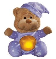 """Lullaby Night Time Bear So cute and comforting! The star on the bear's belly lights up while he sings """"Brahms' Lullaby."""" Helps your little one drift calmly into dreamland. 8"""" H x 5 3/4"""" W. Plush. Uses 3 button-cell batteries (included). Imported. www.youravon.com/brouleau"""