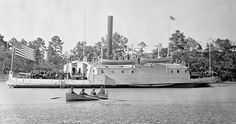 USS Commodore Perry, a ferryboat converted to a gunboat, Pamunkey River, Virginia, USA – circa 1863.  Commodore Perry — an armed, side-wheel ferry — was built in 1859 by Stack and Joyce, Williamsburg, New York; purchased by the Navy on 2 October 1861; and commissioned later in the month, Acting Master F. J. Thomas in command.