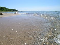 Late afternoon walks on the beach. Find a Petoskey stone. Pick up a feather. These are your tasks for the day in Good Hart.