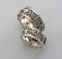 HR Giger inspired his and her wedding ring set with rubies and octopus tentacles