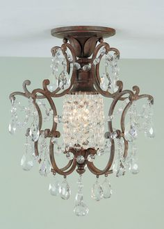 Chandeliers for bathroom seem to be really hot right now in design. Like the ceiling mount on this one as well as sparkley.