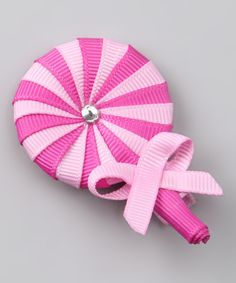 Adding a fun finishing touch to any outfit is easy with this candy alligator clip. Handmade from quality grosgrain ribbon that's been sealed to prevent fraying, it makes the perfect unique gift for any special sweetie. 2'' W x 2'' HGrosgrain ribbon / alligator clipSpot clean...