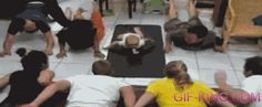 A baby living the dream of leading a yoga class: