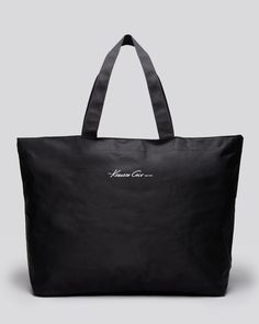 Receive a tote bag with any full price purchase of Kenneth Cole New York