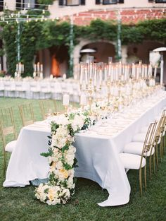 Gorgeous garland + candelabra topped tablescape: http://www.stylemepretty.com/2016/03/11/european-inspired-california-estate-wedding/ | Photography: Lane Dittoe - http://lanedittoe.com/