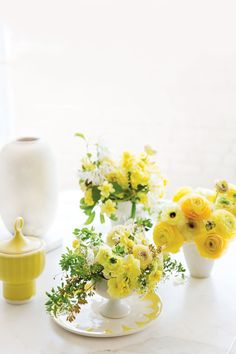 You can make your own Yellow Ranunculus centerpiece thanks to Ariella Chezar.