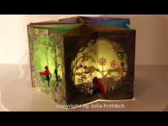 "Beautiful Pop-up carousel book (""Little Red Riding Hood"") with a light inside"