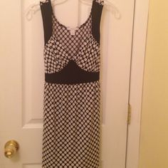 Black and white polka dot tank Really cute black and white polka dot long tank with tie in back. Dress Barn Tops Tank Tops