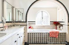 Mix and Chic: Inside a beautifully layered and charming Spanish Colonial Revival in Los Angeles! White Medicine Cabinet, Medicine Cabinets, Leaded Glass Windows, Spanish Colonial, Spanish Revival, Spanish Homes, Front Courtyard, Black And White Tiles, Celebrity Houses