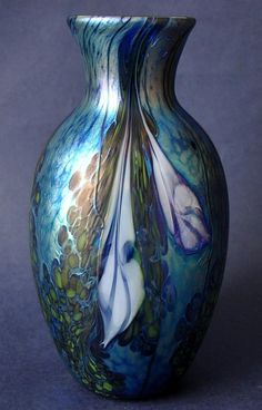 Richard Golding Station Glass Blue Iridescent Vase With White Flowers  http://www.bwthornton.co.uk/isle-of-wight-richard-golding-bath-aqua-glass.php