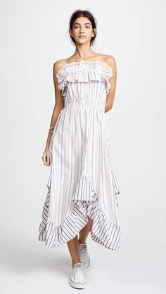 MISA Virginie Dress. Stripes in soft, warm colors cover this breezy MISA dress, giving the piece a casual, summer-ready feel. Elastic refines the waist and secures the top hem, and the hem lifts and dips like a wave.