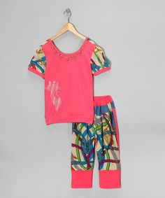 Nothing says fun quite like this trendy set. The top is accented by a sewn-in necklace, puff sleeves and sparkle-kissed print, while the leggings feature a stay-put elastic waistband and contrast prints.Includes top and leggingsTop: 100% cottonLeggings: 100% polyesterMachine wash; tum...