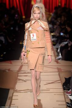 Taped: Even the catwalk was made of cardboard with models sporting matching shoes...