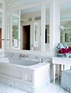 Art Deco–inspired THG tub fittings gleam in the serene master bath.