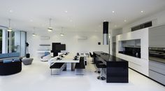 Extraordinary Futuristic Interior Applied in a Futuristic House Design : Modern White Chairs With Black Sofa Lather For White Dining Table W. Minimal House Design, Minimal Home, Minimalist Design, Minimalist House, Design Minimalista, White Dining Table, Interior Architecture, Interior Design, House Inside