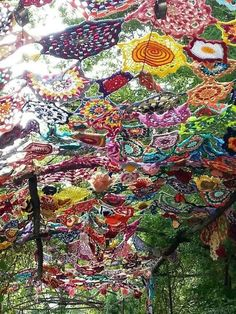 yarn bombing.  Would make a great cover for a metal pop-up frame, or old umbrella frame