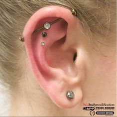 """Industrial/ear project by Jesus """"Sala"""" Cabanas of Pinpoint body piercing. Jewelry by Neometal and Industrial Strength."""
