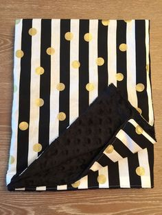 New Black/White/Gold Stripes Print Baby Blanket measures approximately 28x36inches. This makes a great gift for a baby shower! Cotton and