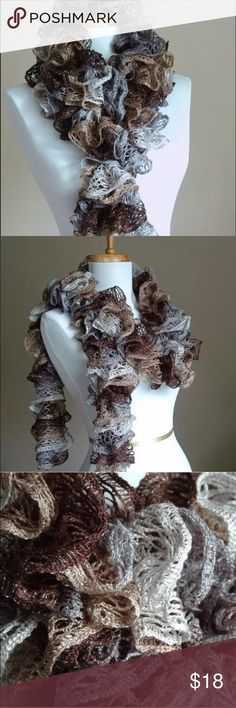 """Sashay Ruffle Light Weight Scarf Taupe Brown Grey New handmade gorgeous hand knit scarf made from Red Heart Boutique Sashay yarn in """"Waltz"""" Soft shades of Grey, Browns Taupe that fade from one into the other. When the yarn is knit it forms soft ruffles from an intricate mesh design with a silver metallic edge. Very lightweight and not scratchy around your neck. The perfect accessory! Approx :- 58- 62 inches long and 3/4 inches wide Made in a smoke free and pet free home. See my other items…"""