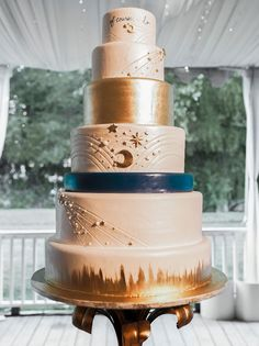 celestial-inspired starry gold tiered wedding cake