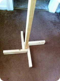 Sally Ann: DIY clothing rack - this base could be used for many other things besides a clothes rack.
