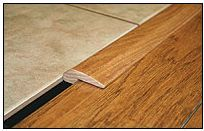 Threshold: An extremely versatile floor mold, thresholds are also ideal for transitioning between flooring of different heights. Their use goes beyond hardwood floors; they can also be used to adjoin tile and carpet.