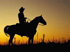 Cowboy on a horse in the sunset.. can't get much better than that...