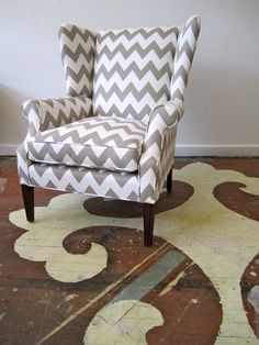 gray chevron wing back chair and painted stenciled floor