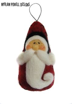 Christmas ornament - Santa Ornament - Needle Felted Santa - Santa Claus  This cute santa ornament has a triangle shape. He is made of red wool felt and wool roving. His face, hair, and bear are felted with beige and white wool roving. His body is dark red felt, stuffed with poly fil, machine and hand stitched with black wool DMC. This santa measures 4 (10 cms). He would be a beautiful addition to your Christmas tree or a wonderful gift for people who collect ornaments. This ornament is…