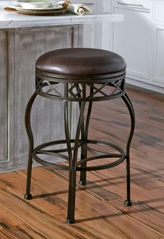 """The Skylar Swivel Barstool is a elegant and adaptable piece. This stool comes with 6"""" leg extenders to convert from a 24"""" counter stool to a 30"""" bar stool. The tubular welded metal construction and durable powder coated textured Bronze finish are sure to stand the test of time."""