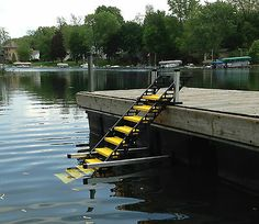 Kayak Storage Pallets The provides a convenient, removable option for your dog to get out of the water without swimming back to shore or trying to scale a seawall or rip rap. The also works great for floating swim platforms. Lake Toys, Floating Dock, Floating Homes, Dog Ramp, Kayak Storage, Lakefront Property, Boat Lift, Lake Cottage, Boat Dock