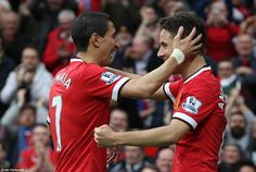 United substitute Angel di Maria (left) congratulates Herrera after his injury time goal restores United's two-goal advantage