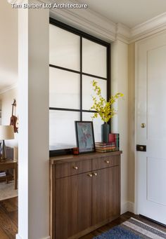 Front door open into the living room? This solution feels more intentional than a bookcase as a divider.