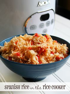Basic Spanish Rice recipe in the Rice Cooker.  1 1/2 cups uncooked white rice 1 1/2 cups chicken broth 1 can of Rotel tomatoes 2 tablespoons of melted butter 1 teaspoon cumin