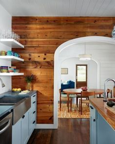 A Small Bungalow Gets a Second Story Beautifully updated kitchen in a small bungalow that exposed the original shiplap walls (Clayton & Little Architects in Austin, Texas). Sweet Home, Home Renovation, Home Remodeling, Cottage Renovation, Kitchen Dining, Kitchen Decor, Kitchen Walls, Kitchen Wood, Bronze Kitchen