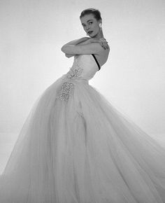 Susan Abraham in John Cavanagh's strapless evening gown, photo John French, London, UK, Spring 1954.
