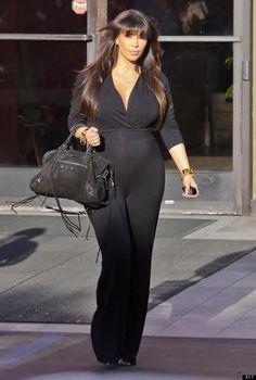 Reality Star Kim Kardashian Flaunts Baby Bump In Jumpsuit