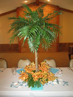 We created this palm tree for a  tropical-themed party. www.fancyfloralsbynancy.com www.facebook.com/fancyfloralsbynancy