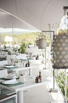 Atzaro Beach, stylish beach restaurant. Cala Nova. A spectacular white canopy provides a shaded respite from the heat, overlooking Cala Nova's sparkling turquoise waters