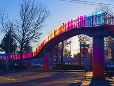 Inspired by the sunrise, this project transforms an aging pedestrian bridge into a community landmark. Pedestrian Bridge, Amazing Gifs, Amazing Art, Sound Wall, Across The Bridge, Public Realm, Public Art, Seattle Washington, Global Art