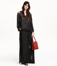 Wide-cut chiffon pants with pleats at front. Side pockets, one welt back pocket, high slits at sides, and concealed side zip. Lined with short shorts.