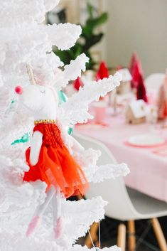 's colorful Nutcracker decorating theme really pops against the wintery branches of her Frozen Fir. White Flocked Christmas Tree, Flocked Artificial Christmas Trees, Flocked Christmas Trees, Christmas Tree Wreath, Colorful Christmas Tree, Nutcracker Christmas, Green Christmas, Wreaths And Garlands, Flocking