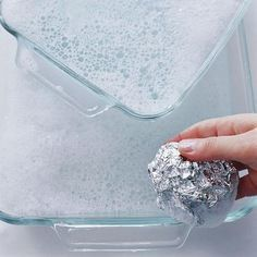 Aluminum foil as glassware scrubber: To get baked-on food off a glass pan or an oven rack, use dishwashing liquid and a ball of foil in place of a steel-wool soap pad. Plus more tips from Real Simple Household Cleaning Tips, Cleaning Recipes, Cleaning Hacks, Cleaning Supplies, Household Cleaners, Diy Cleaners, Cleaners Homemade, Glass Pan, Do It Yourself Baby