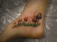 Mushroom tattoo: The placement is gross, fungus in a foot? Eew but smaller on my arm would be cute