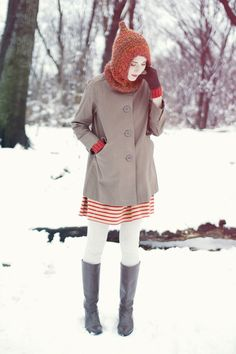 I wish I were standing right now in that snow wearing this exact outfit.  Too cute.