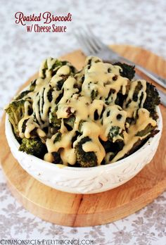 Roasted Broccoli with Cheese Sauce Recipe ~ Broccoli florets roasted with olive oil and topped with an easy-to-make cheddar cheese sauce. Simply delicious.