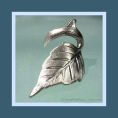 Leaf Ear cuff earring jewelry, Antiqued silver, Rose Thorn Earcuff for men and women. $39.00, via Etsy.