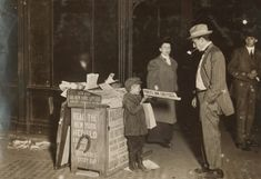 Jerald Schaitberger 7 yrs. old, of 416 W. 57th St. N.Y. as he helps to sell papers until 10 P.M. on Columbus Circle. Photo taken 9:30 P.M. on October 8, 1910. Photo by Paul B. Schumm. LOC