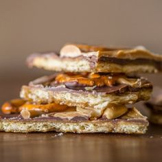 A butter cracker base with layers of caramel, chocolate, peanut butter, pretzels and peanuts! So delicious and addicting!
